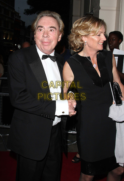 Sir Andrew Lloyd Webber & Lady Madeleine Lloyd Webber.GQ Men of the Year Awards at the Royal Opera House, Covent Garden, London, England..September 4th 2012.half length black dress sleeveless tuxedo bow tie married husband wife holding hands profile .CAP/ROS.©Steve Ross/Capital Pictures.