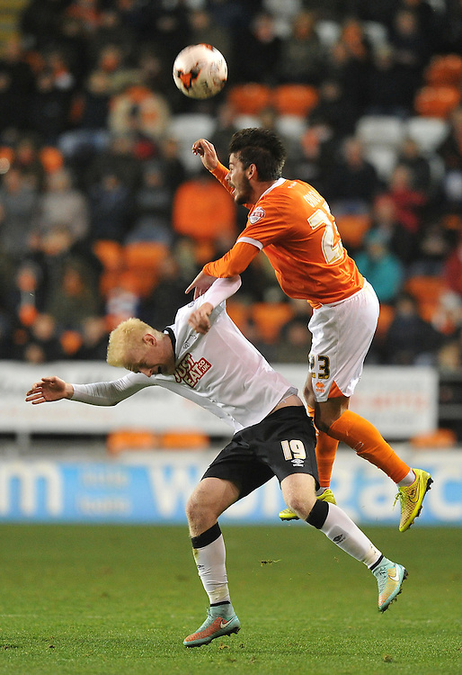 Blackpool's Edu Oriol out jumps Derby County's Will Hughes<br /> <br /> Photographer Dave Howarth/CameraSport<br /> <br /> Football - The Football League Sky Bet Championship - Blackpool v Derby County - Tuesday 21st October 2014 - Bloomfield Road - Blackpool<br /> <br /> &copy; CameraSport - 43 Linden Ave. Countesthorpe. Leicester. England. LE8 5PG - Tel: +44 (0) 116 277 4147 - admin@camerasport.com - www.camerasport.com