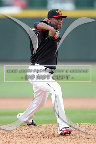 Rochester Red Wings pitcher Jose Lugo (19) delivers a pitch during a game vs. the Buffalo Bisons at Frontier Field in Rochester, New York;  September 6, 2010.  Buffalo defeated Rochester 16-1 in the season finale for both teams.  Photo By Mike Janes/Four Seam Images