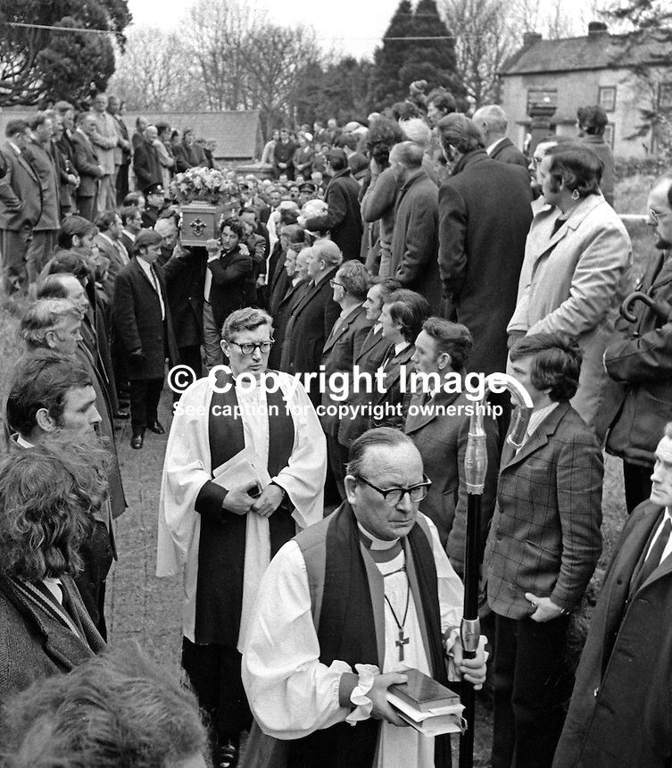 The Church of Ireland Bishop of Clogher, Dr R W Heavener, followed by the local clergyman, Rev T J Gray, head the funeral cortege of Senator Billy Fox, 35 years, Protestant, Fine Gael politician, Co Monaghan, Rep of Ireland, 14th March 1974 as it arrives Aughamullen Parish Church, Castleblaney. Fox was previously a TD (Irish MP).  He was visiting the home near Clones of his fiancee, Marjorie Coulson, which unknown to him had been taken over by thirteen armed paramilitaries. He ran from the scene but was followed and shot dead in a nearby field. Five members of the Provisional IRA were subsequently tried and convicted of the killing. 197403140164f. .Copyright Image from Victor Patterson, 54 Dorchester Park, Belfast, United Kingdom, UK...For my Terms and Conditions of Use go to http://www.victorpatterson.com/Victor_Patterson/Terms_%26_Conditions.html