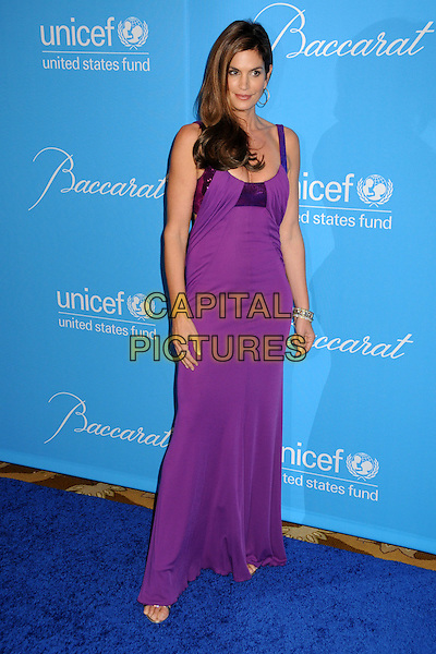 CINDY CRAWFORD.UNICEF Ball 2009 Honoring Jerry Weintraub held at the Beverly Wilshire Hotel, Beverly Hills, California, USA..December 10th, 2009.full length dress purple maxi sequins sequined .CAP/ADM/BP.©Byron Purvis/AdMedia/Capital Pictures.