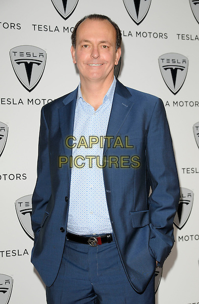 QUENTIN WILSON.The Tesla UK launch party, Tesla Motors Ltd., Cheval Place, London, England..June 25th, 2009.half length blue suit jacket shirt hand sin pockets .CAP/CAN.©Can Nguyen/Capital Pictures.