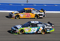 Oct. 11, 2009; Fontana, CA, USA; NASCAR Sprint Cup Series driver Carl Edwards (99) races alongside Jeff Burton (31) during the Pepsi 500 at Auto Club Speedway. Mandatory Credit: Mark J. Rebilas-