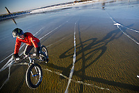 Biking on a clear smooth frozen Lake Michigan with studded tires and a fat bike snow bike in Michigan.