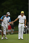 7 September 2008:    Camilo Villegas of Medellin, Colombia, South America hands a ball to his caddy Gary Mathews on the ninth hole in the delayed third round of play at the BMW Golf Championship at Bellerive Country Club in Town & Country, Missouri, a suburb of St. Louis, Missouri on Sunday September 7, 2008. He and 23 other golfers had to finish their third round of competition Sunday morning before the fourth and final round could be played due to the suspension of third round play because of darkness on Saturday Sept. 6.  The BMW Championship is the third event of the PGA's  Fed Ex Cup Tour.