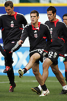 7 May 2005.  DC United's Ben Olsen (14) warms up with the team before the beginning of the game at RFK Stadium in Washington, DC.