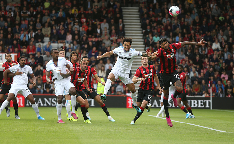 West Ham United's Felipe Anderson and Bournemouth's Philip Billing challenge for a cross<br /> <br /> Photographer Rob Newell/CameraSport<br /> <br /> The Premier League - Bournemouth v West Ham United - Saturday 28th September 2019 - Vitality Stadium - Bournemouth<br /> <br /> World Copyright © 2019 CameraSport. All rights reserved. 43 Linden Ave. Countesthorpe. Leicester. England. LE8 5PG - Tel: +44 (0) 116 277 4147 - admin@camerasport.com - www.camerasport.com