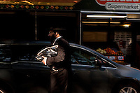An Hassidic Jewish men walks in Williamsburg neighborhood of the New York City borough of Brooklyn, NY, Monday August 1, 2011. Williamsburg have many ethnic groups have enclaves and an important Hasidic Jews community, most belonging to the Satmar Hasidic group.