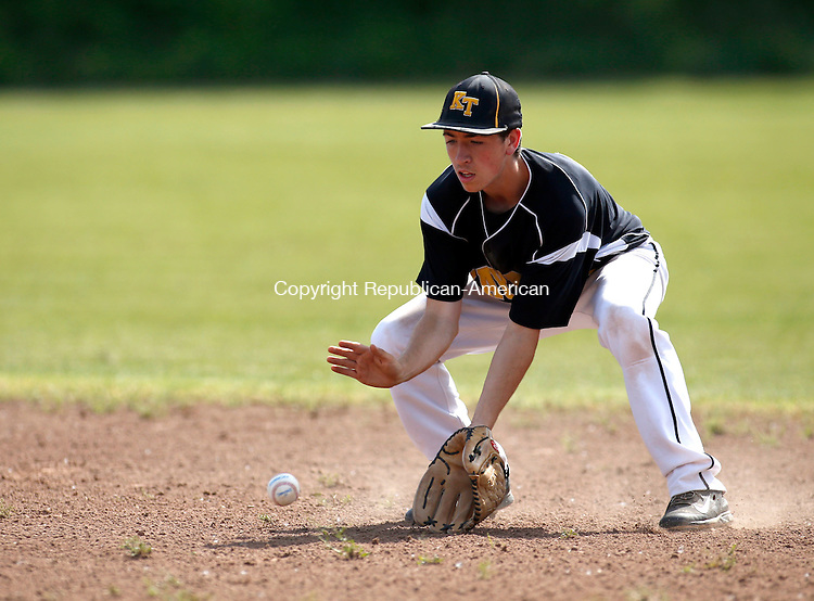Waterbury, CT- 03 June 2015-060315CM04- Kaynor Tech's Jack Petrucci comes up with a ground ball during their state playoff matchup against Lewis Mills in Waterbury on Wednesday.    Christopher Massa Republican-American