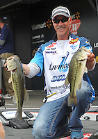 NWA Democrat-Gazette/Michael Woods --04/24/2015--w@NWAMICHAELW... Pro fisherman Andy Morgan from Dayton Tennessee holds up a pair of fish caught during day 2 of the Walmart FLW tournament on Beaver Lake. Morgan moved into 1st place for day two with a total weight of 28 pounds 9 ounces.