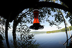 View from Wildway porch of lake with humming bird feeder