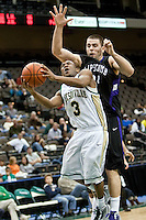January 14, 2010:    Jacksonville guard Ben Smith (3) is fouled by Lipscomb center Adnan Hodzic (34) while going up for a basket during Atlantic Sun conference game action between the Jacksonville Dolphins and the Lipscomb Bisons at Veterans Memorial Arena in Jacksonville, Florida.  Jacksonville defeated Lipscomb 79-73.