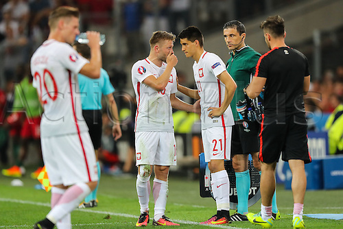 30.06.2016. Marseille, France. UEFA EURO 2016 quarter final match between Poland and Portugal at the Stade Velodrome in Marseille, France, 30 June 2016.   Bartosz Kapustka (POL), Jakub Blaszczykowski  discuss penalty kicks
