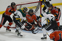 Goalie Alex Blum #1 of Bethel Park makes a save in front of traffic in the third period against Penn-Trafford during their PIHL semifinal game at the Robert Morris University Island Sports Center on Neville Island on March 21, 2012 in Pittsburgh, PA...(Jared Wickerham/For The Tribune-Review).JWPT-Bethel322.jpg.