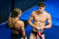 Picture by Rogan Thomson/SWpix.com - 18/07/2017 - Diving - Fina World Championships 2017 -  Duna Arena, Budapest, Hungary - Dan Goodfellow of Great Britain looks frustrated with the result after diving in the Mixed Team Event Final with Robyn Birch.