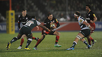 Alex Goode of Saracens is tackled by Lachlan McCaffrey and Vereniki Goneva of Leicester Tigers during the Premiership Rugby match between Saracens and Leicester Tigers - 02/01/2016 - Allianz Park, London<br /> Mandatory Credit: Rob Munro/Stewart Communications
