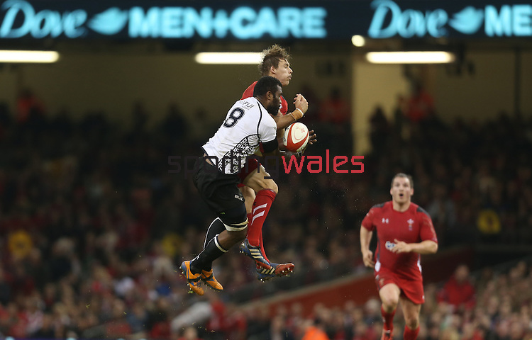 Wales fullback Liam Williams and Fiji number 8 Masi Matadigo compete for the high ball.<br /> Dove Men Series 2014<br /> Wales v Fiji<br /> Millennium Stadium<br /> 15.11.14<br /> ©Steve Pope-SPORTINGWALES