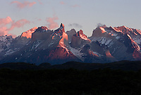 The sun rises over the Paine massif, with it's distinctive cuernos, or horns, at center at Torres del Paine National Park in southern Chile. (Kevin Moloney for the New York Times)