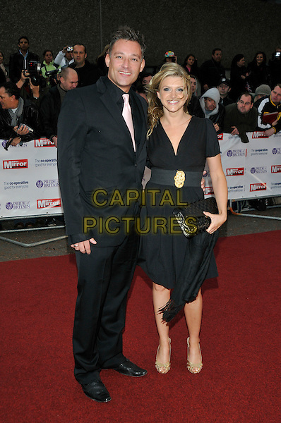 TOBY ANSTIS & LILY BRAZIER .Arriving at the Pride of Britain Awards,.London Television Centre, South Bank, London, England, UK, .30th September 2008 .full length black suit tie dress belt clutch bag .CAP/PL .©Phil Loftus/Capital Pictures