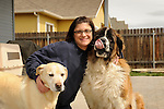 Matisse Weigle with Balou and Retriever in backyard.