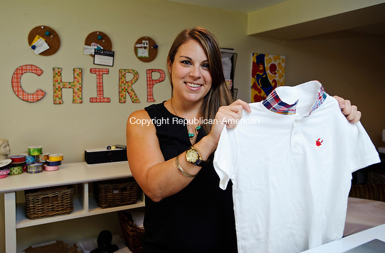 BEACON FALLS, CT-25 JULY 2012--072512JS06-Adrienne Hofmann of Beacon Falls shows off a shirt that is part of her line of baby clothing. .Jim Shannon Republican-American