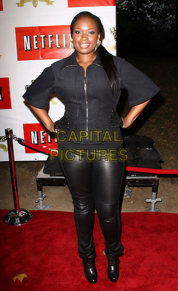 """JENNIFER HUDSON .Attending a free outdoor concert and movie screening of """"The Wizard of Oz"""" hosted by NETFLIX, New York, NY, USA,.29th September 2009..full length black zip up jacket leather pvc rubber shiny leggings gloves hands on hips .CAP/ADM/PZ.©Paul Zimmerman/AdMedia/Capital Pictures."""