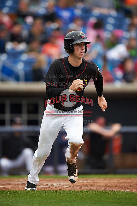 Quad Cities River Bandits center fielder Kyle Tucker (19) runs to first during a game against the Burlington Bees on May 9, 2016 at Modern Woodmen Park in Davenport, Iowa.  Quad Cities defeated Burlington 12-4.  (Mike Janes/Four Seam Images)