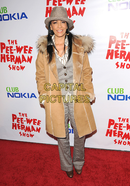 SHEILA E. (Sheila Escovedo).The The Pee-Wee Herman Show Opening Night held at Club Nokia at L.A. Live in Los Angeles, California, USA..January 20th, 2010.full length brown beige hat sheepskin jacket coat hands in pockets grey gray waistcoat .CAP/RKE/DVS.©DVS/RockinExposures/Capital Pictures.