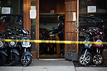 The NYPD investigates a homicide at Fly E-Bike at 662 Nostrand Avenue on July 18, 2020 in the Crown Heights neighborhood of the Brooklyn borough of New York City.  The 23 year-old victim, who died at Kings County, was shot in the leg and stomach.  Photograph by Michael Nagle
