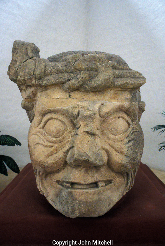 Maya Toothless Old Man of Copan or Pauahtun head from Temple 11, Copan Sculpture Museum, Copan, Honduras