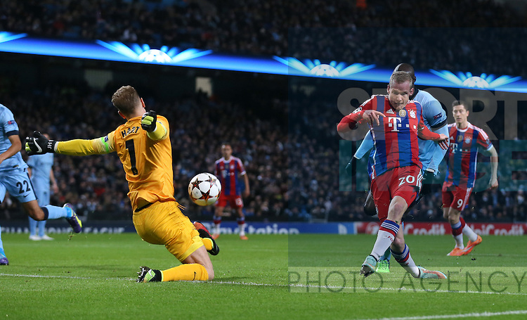 Joe Hart of Manchester City makes early save from Sebastian Rode of Bayern Munich - UEFA Champions League group E - Manchester City vs Bayern Munich - Etihad Stadium - Manchester - England - 25rd November 2014  - Picture Simon Bellis/Sportimage