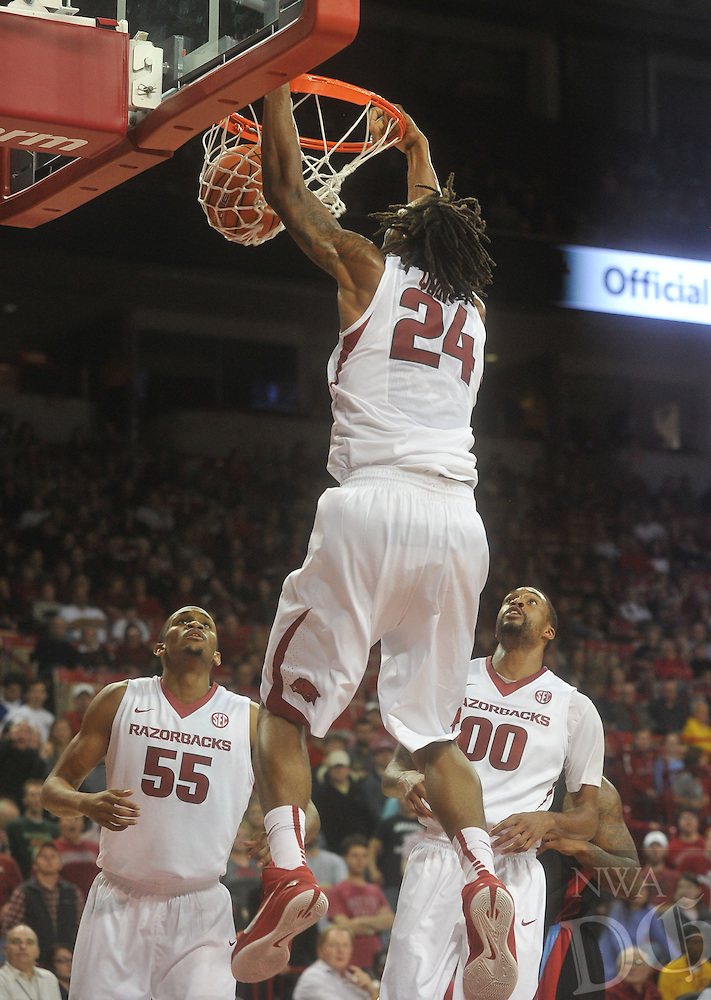 NWA Media/Michael Woods --11/21/2014-- w @NWAMICHAELW...University of Arkansas forward Michael Qualls goes up for the dunk during the second half of Friday nights game  against Delaware State at Bud Walton Arena in Fayetteville.