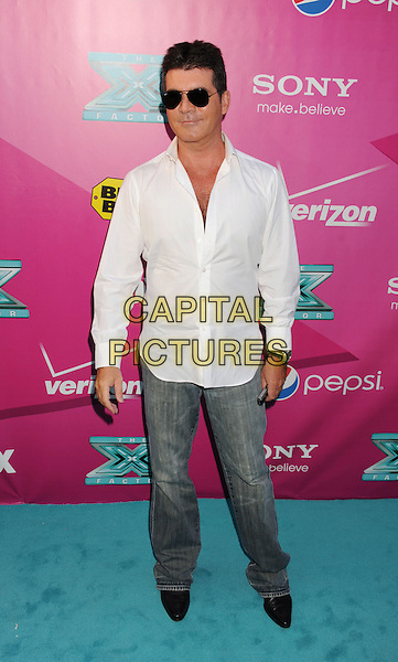 Simon Cowell.'The X Factor' Season 2 Premiere Party at Grauman's Chinese Theatre, Hollywood, California, USA..11th September 2012.full length white shirt jeans denim sunglasses shades .CAP/ROT/TM.© TM/Roth/Capital Pictures
