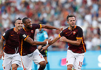 Calcio, Serie A: Roma vs Juventus. Roma, stadio Olimpico, 30 agosto 2015.<br /> Roma&rsquo;s Miralem Pjanic, right, celebrates with teammate Seydou Keita, center, and Roma&rsquo;s Radja Nainggolan, after scoring during the Italian Serie A football match between Roma and Juventus at Rome's Olympic stadium, 30 August 2015.<br /> UPDATE IMAGES PRESS/Riccardo De Luca