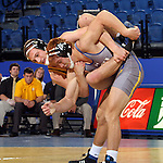 BROOKINGS, SD - NOVEMBER 9:  Joe Brewster from South Dakota State tries to flip Jason Fugiel from Drexel in their 165 pound match Saturday at Frost Arena. (Photo by Dave Eggen/Inertia)