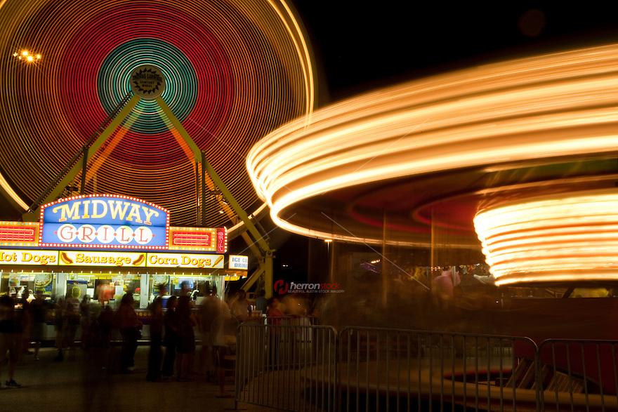 Ferris wheel and crowd at carnival, night (long exposure) austin, texas