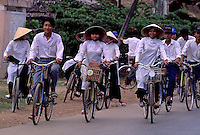 "Traditional Vietnamese Girls on their Bikes, circa 1992. Near Can Tho, the hub of the Mekong Delta (Vietnamese: Đồng bằng Sông Cửu Long ""Nine Dragon river delta""), also known as the Western Region (Vietnamese: Miền Tây or the South-western region (Vietnamese: Tây Nam Bộ) is the region in southwestern Vietnam where the Mekong River approaches and empties into the sea through a network of distributaries. The Mekong delta region encompasses a large portion of southwestern Vietnam of 39,000 square kilometres (15,000 sq mi). The size of the area covered by water depends on the season.<br />
