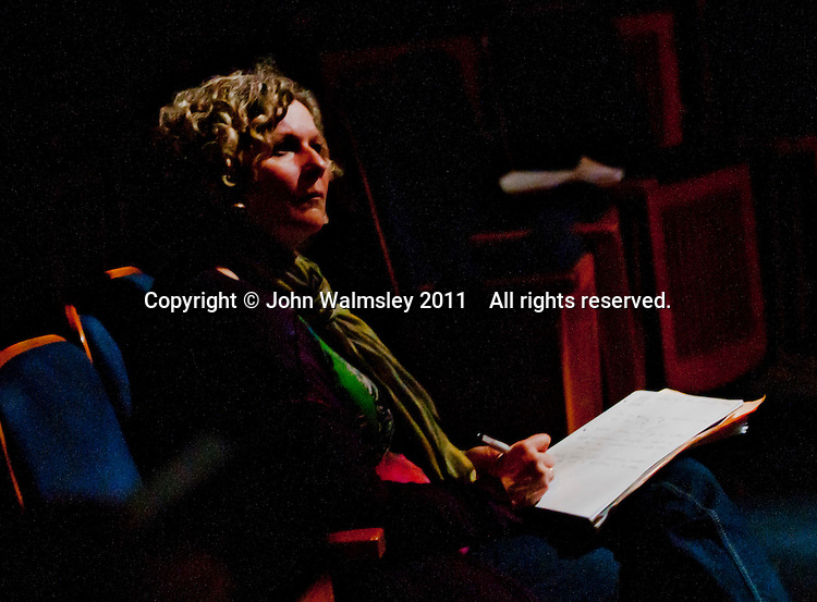 The Director, Natasha  Betteridge, taking notes during the dress rehearsal for Shakespeare's Macbeth, Rose Bruford College, Sidcup, Kent.