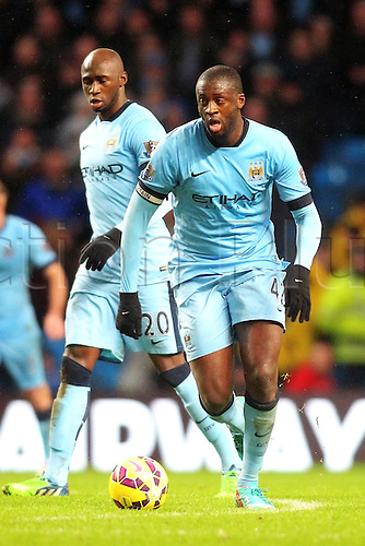 01.01.2015.  Manchester, England. Barclays Premier League. Manchester City versus Sunderland. Manchester City midfielder Yaya Toure runs with the ball
