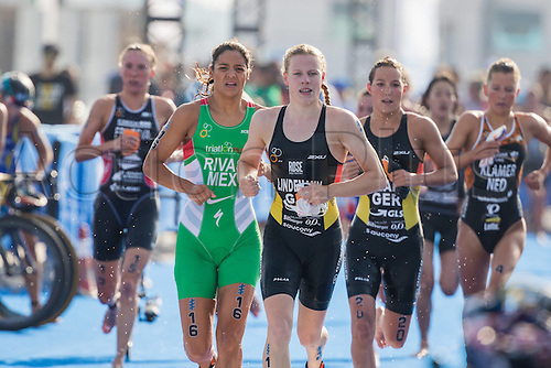 05.03.2016. Abu Dhabi, UAE. 2016 ITU Abu Dhabi World Triathlon.  Laura Lindemann and Anja Knapp leave the swim leg to the bike transition