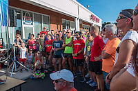 Runners of all sizes and ages listen to U.S. running Legend Meb Keflezghi at Fleet Feet's Run with Meb event, promoting the St. Louis Rock and Roll Marathon and it's new course, unveiled Wednesday, September 3, 2014 at the Fleet Feet store in Des Peres, MO.