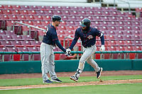 Cedar Rapids Kernels Chris Williams (32) is congratulated by manager Brian Dinkelman (12) after hitting a home run during a Midwest League game against the Kane County Cougars at Northwestern Medicine Field on April 28, 2019 in Geneva, Illinois. Cedar Rapids defeated Kane County 3-2 in game two of a doubleheader. (Zachary Lucy/Four Seam Images)