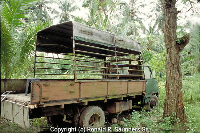 OLD MILITARY TRUCK ON ISLAND OFF THE COAST OF SINGAPORE