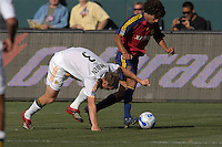 LA's Ty Harden stumbles as RSL's Medhi Ballouchy dribbles upfield. The Los Angeles Galaxy defeated Real Salt Lake, 3-2, at the Home Depot Center in Carson, CA on Sunday, June 17, 2007.