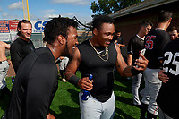 Batavia Muckdogs Edison Suriel (left) and Albert Guaimaro (right) celebrate after clinching the Pinckney Division Title during a NY-Penn League game against the Auburn Doubledays on September 2, 2019 at Falcon Park in Auburn, New York.  Batavia defeated Auburn 7-0 to clinch the Pinckney Division Title.  (Mike Janes/Four Seam Images)