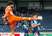 Close call for Luke O'Nien of Wycombe Wanderers as he nearly takes a Kelvin Mellor of Blackpool boot during the Sky Bet League 2 match between Wycombe Wanderers and Blackpool at Adams Park, High Wycombe, England on the 11th March 2017. Photo by Liam McAvoy.
