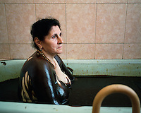Albina Visilova, a patient at the Naftalan Sanatorium sits in a bath of oil. Each session, patients bathe for ten minutes in a tub of crude oil. The oil is heated to 37 degrees for optimum effectiveness..