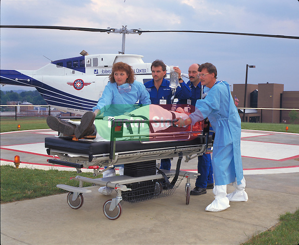 EMT's and doctors bringing in emergency patient by helicopter