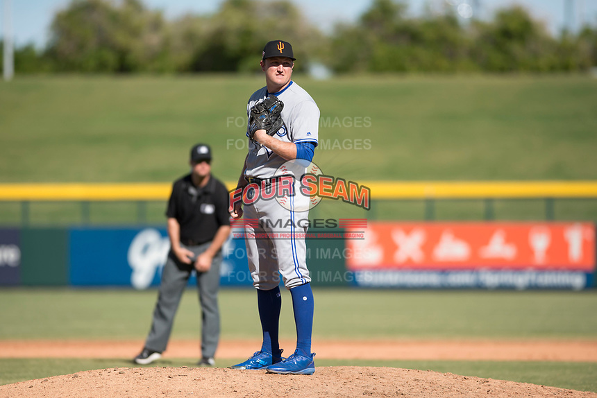 Surprise Saguaros relief pitcher Zach Jackson (36), of the Toronto Blue Jays organization, looks in for the sign during an Arizona Fall League game against the Mesa Solar Sox at Sloan Park on November 1, 2018 in Mesa, Arizona. Surprise defeated Mesa 5-4 . (Zachary Lucy/Four Seam Images)
