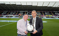 Match ball sponsor with club ambassador Lee Trundle before the Barclays Premier League match between Swansea City and Liverpool at the Liberty Stadium, Swansea on Sunday May 1st 2016